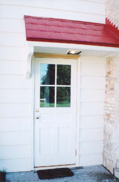 The rear entrance of the station with new red roof shingles and Stallion door. Dan Wright President of Stallion Doors donated the doors. & Photo Album Page 5 pezcame.com